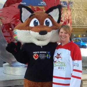 Renee McCloskey volunteering with Nanguz the Fox from the 2015 Canada Winter Games.