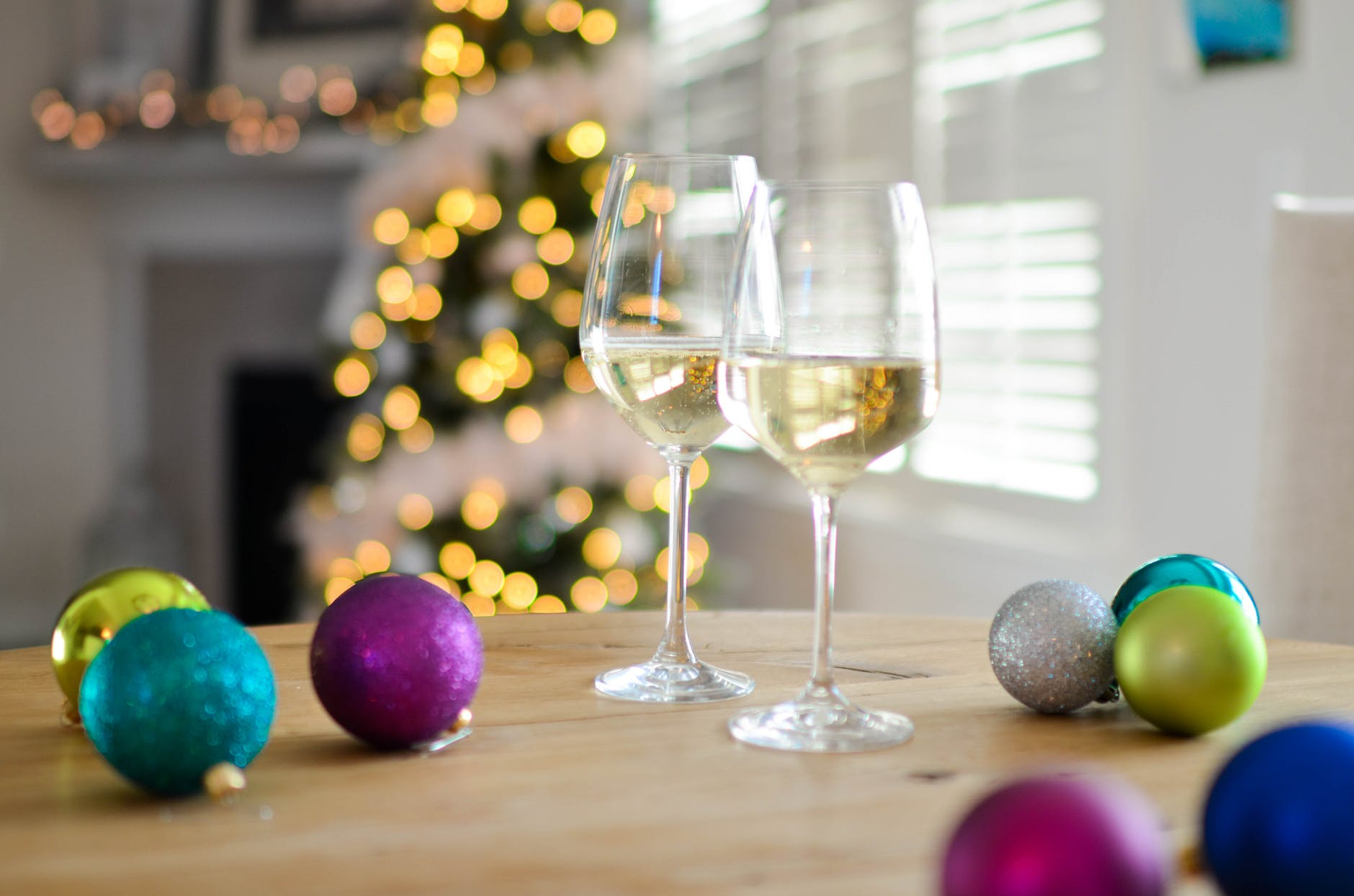 two champagne glasses near baubles